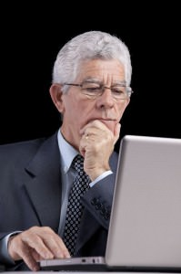 older man at computer