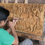Artist carving wood picture