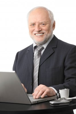 Older man working on laptop