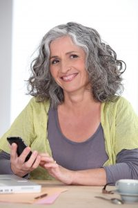 Older woman using a mobile phone