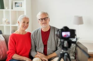 Older couple creating video for online business