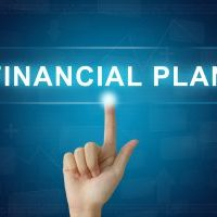 financial-planning-finger-pointing-on-electronic-board