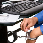 Unlocking the handcuffs that tied the hand to the work desk.