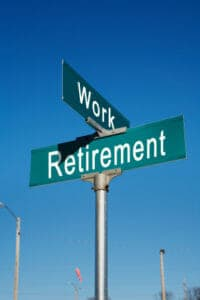 Signpost pointing to work and retirement in different directions