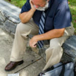 man sitting outside with briefcase